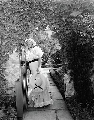 Toby Wing Standing In A Garden Gateway Poster by George Hoyningen-Huene