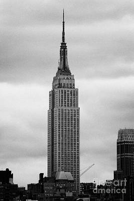 Top Of The Empire State Building Above Skyline And Grey Cloudy Sky New York City Poster by Joe Fox