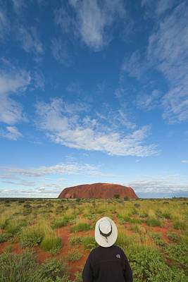 Tourist And Clouds At  Ayers Rock Poster