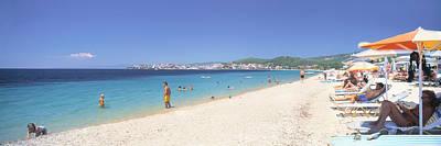 Tourist On The Beach, Porto Carras Poster