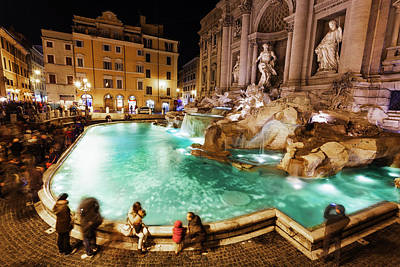 Tourists At Trevi Fountain At Nighttime Poster
