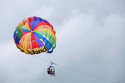Tourists Parasailing Off Green Island Poster