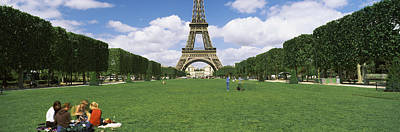 Tourists Sitting In A Park With A Tower Poster by Panoramic Images