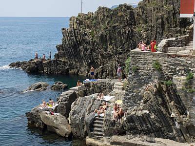 Tourists Sunbathing On The Rocks Poster