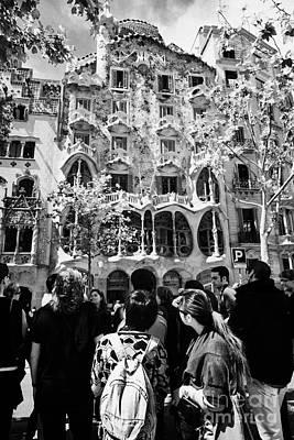 tourists tour group outside casa batllo modernisme style building in Barcelona Catalonia Spain Poster