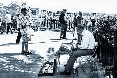 tourists watching busker playing santoor dulcimer at Tarragona S Poster