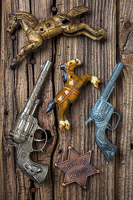 Toy Guns And Horses Poster by Garry Gay