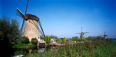 Traditional Windmills In A Field Poster by Panoramic Images