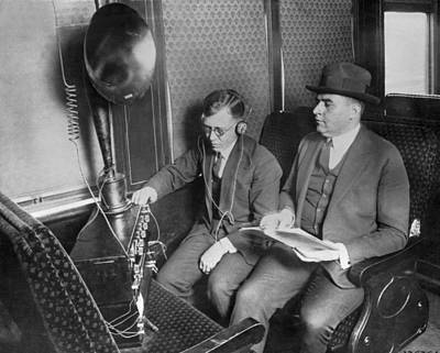Train Passengers Enjoy Radio Poster by Underwood Archives