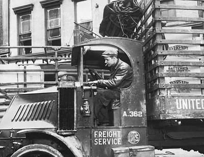 Truck Driver In His Cab Poster by Underwood Archives