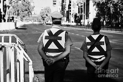 two carabineros de chile national police officers with roads closed Santiago Chile Poster