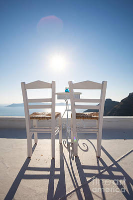 Two Empty Chairs Overlooking Blue Mediterranean Sea In Santorini Poster by Matteo Colombo