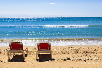 Two Empty Sun Loungers On Beach By Sea Poster