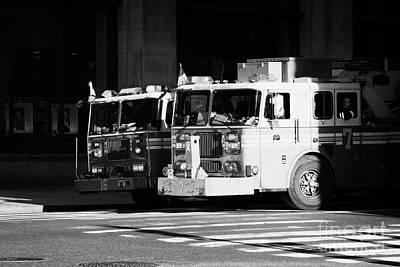 two FDNY fire engines 16 and 7 wait beside crosswalk 34th Street new york city Poster by Joe Fox