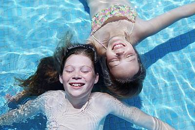 Two Girls Floating In Water Poster