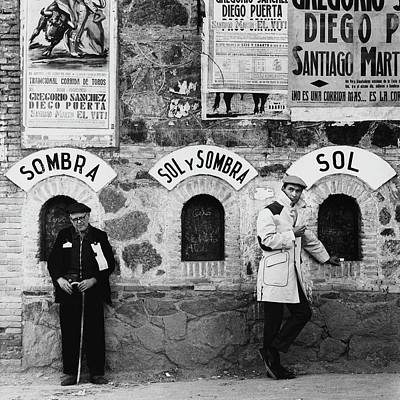 Two Men Posing By A Wall Covered In Spanish Poster by Chadwick Hall