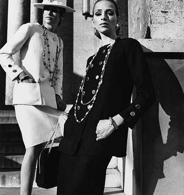 Two Models Wearing Chanel Suits Poster