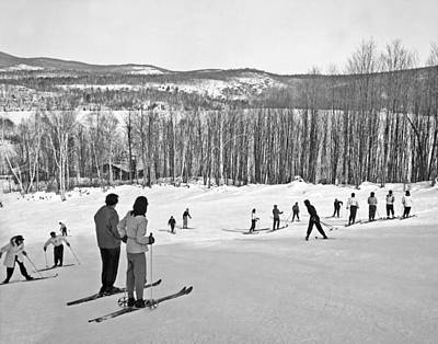 Two Skiers Pause On A Slope Poster by Underwood Archives