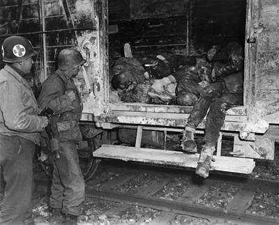 Two U.s. Soldiers Looking At Dead Poster by Everett
