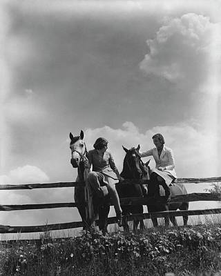 Two Women Sitting On A Fence With Horses Poster