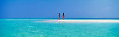 Two Women Standing On The Beach Poster