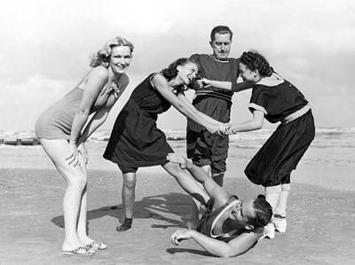 Two Women Tussle On The Beach Poster