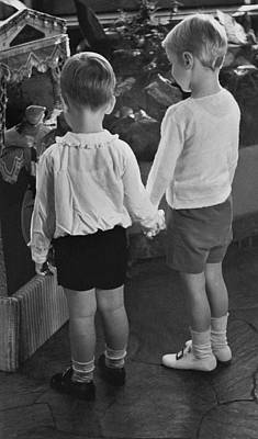 Two Young Boys Holding Hands Poster