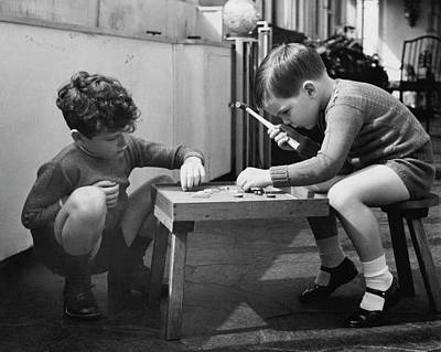 Two Young Boys Sitting By A Wooden Table Poster by Remie Lohse