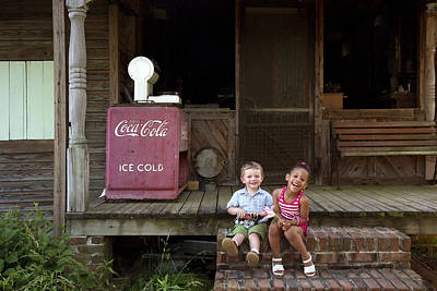 Two Young Children Pose On The Steps Of A Historic Cabin In Rural Alabama Poster