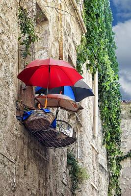 Umbrellas On The Balcony Poster