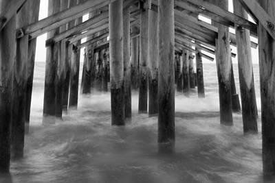 Under The Pier At Kure Beach Poster by Mike McGlothlen
