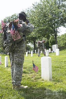 U.s. Army Soldiers Place Flags In Front Poster by Stocktrek Images
