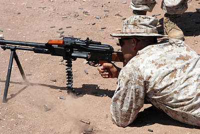U.s. Marine Corps Sgt. Fires A Pkm Poster by Everett