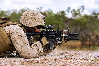 U.s. Marine Fires Rounds Down Range Poster by Stocktrek Images