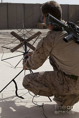 U.s. Marine Repositions A Satellite Poster by Stocktrek Images