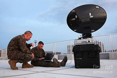U.s. Marines Set Up A Satellite System Poster by Stocktrek Images