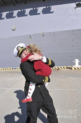 U.s. Navy Commander Hugs His Daughter Poster