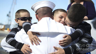 U.s. Navy Sailor Embraces His Sons Poster by Stocktrek Images