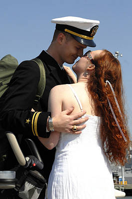 U.s. Navy Sailor Holds His Wife Poster by Stocktrek Images