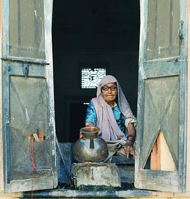 Varanasi Water Seller Poster by Shaun Higson