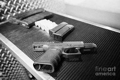 Various Rifle Assault Weapon Pistol Magazines And Shotgun Shells With 9mm Glock Handgun At A Gun Ran Poster