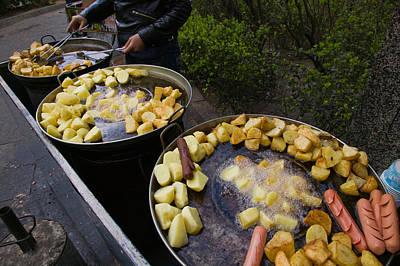 Vendor Selling Deep Fried Potatoes Poster