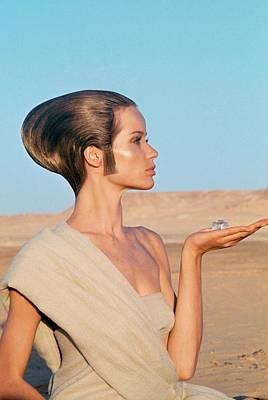 Veruschka Von Lehndorff Sitting In A Desert Poster by Franco Rubartelli