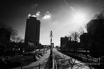 view looking along the Brooklyn bridge in blue sky with winter sunshine sun new york Poster