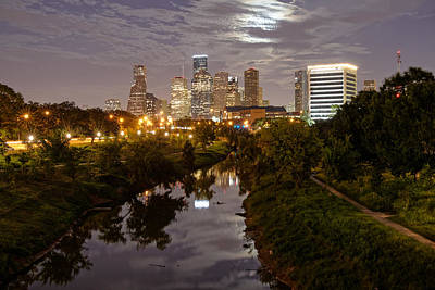 View Of Downtown Houston Skyline And Buffalo Bayou Waterway With Super Moon Rising Behind The Clouds Poster by Silvio Ligutti