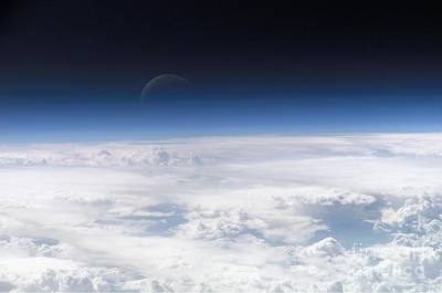View Of The Crescent Moon Through The Top Of The Earths Atmosphere Poster by Paul Fearn