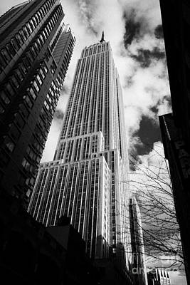 View Of The Empire State Building And Surrounding Buildings And  Cloudy Sky From West 33rd Street Ny Poster by Joe Fox
