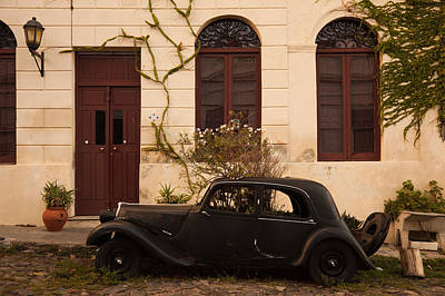 Vintage Car Parked In Front Of A House Poster