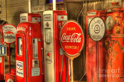 Vintage Gasoline Pumps With Coca Cola Sign Poster