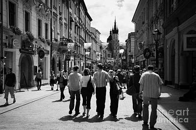 Visitors Walking Down The Ulica Florianska Street Leading Down From City Gates To Old Town City Centre Krakow Poster by Joe Fox